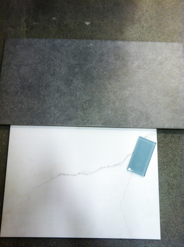Lowe's tile.  Gray for the floor and the marble ceramic for the walls