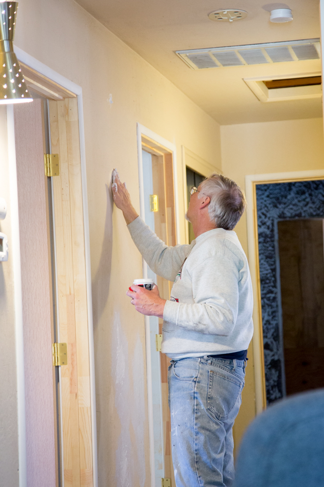 Hubster does some caulking in the hall