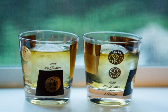 "Scotch on giant ice balls ""rocks"" served in mid-century modern cocktail glasses"