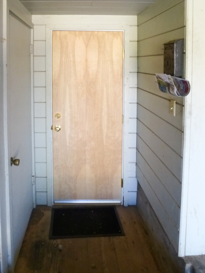 New solid core door in carport